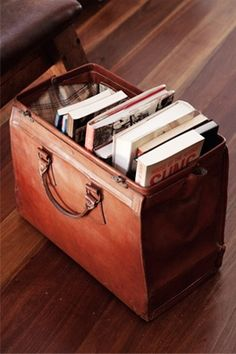 a vintage leather briefcase becomes a great way to store and display books