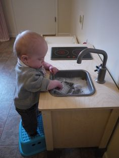 Practical Life Activities 12 months: washing dishes in his kitchen. Providing a child with the right child size materials allows them to do meaningful work independently. Even at a very young age.
