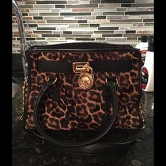 REDUCED ❗️Michael Kors Leopard Hamilton AUTHENTIC .. In Excellent Condition, gold hardware and no wear on fur. PRICE NEGOTIABLE but NO TRADES Michael Kors Bags