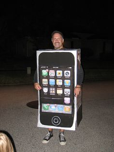 Cut holes in a box for your arms and head, and print out or paint the apps you'd like to display (maybe leave off the WebMD Mobile app you consult whenever you cough more than once in the course of a single day).
