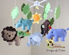 HELLO AND WELCOME TO DROPS OF COLOR! Add a drop of color to your life by decorating your baby room with this gorgeous mobile. **PLEASE READ everything before making your purchase for all details and questions. Thanks! ~DETAILS~ A Made to Order Mobile BIG Safari mobile with many