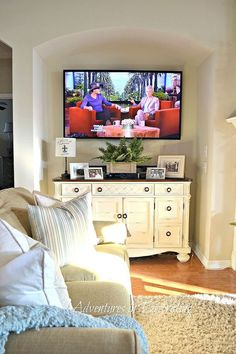 Revamped Great Room :: Hometalk  Idea for decorating under wall mounted TV
