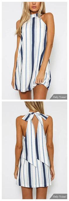 The navy stripe mini dress is a cute little number ideal for the daytime! Featuring a relaxed style, halter neckline, sleeveless mini dress. Style with ankle boots to completed you chic look!
