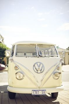 Vintage cream. Lovely. Maybe 2 coloured with the bright colour from the wedding theme? Bridesmaids and family transport idea