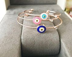 Evil eye jewelry home décor charms beads by EvileyeFavorSupplies Evil Eye Jewelry, Evil Eye Bracelet, Bangle Bracelets, Bangles, Cute Jewelry, Hand Jewelry, Plastic Jewelry, Evil Eye Charm, Rose Gold Jewelry