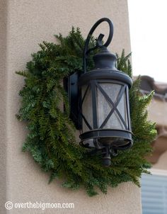 Why haven't i ever thought of this? Christmas Wreath for porch light.
