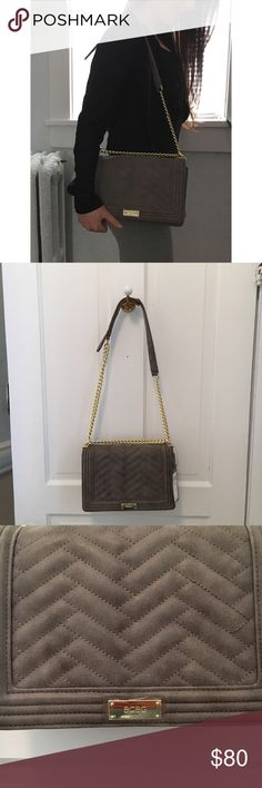 NWT BCBG Over-The-Shoulder Bag - NWT BCBG Over-The-Shoulder Bag  - over-the-shoulder grey suede bag with chevron patterned stitching. Gold chain, and adjustable length strap. Structured body.  - NEW WITH TAGS and original packaging BCBG Bags Shoulder Bags