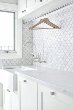 When doing the washing is as much a pleasure as spending time in a fabulous hand-painted timber and marble laundry. | Laundry Design Ideas, fish scale marble tiles | The English Tapware Company