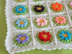 This is traditional Granny Popcorn Bobble Square blanket.It is crocheted from beautiful colored acrylic yarn.The base is cream color, the flowers are 8 colors. You can change any color at the checkout. This baby blanket I made with all my love.It is very cute,soft and warm.It is perfect decoration for