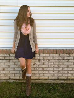 How to wear a jersey dress in cold weather: boots, socks, sweater, & scarf.