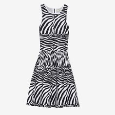 """❤️SALE❤️ NWT Issa Black and White Dress NWT Issa zebra print heavyweight stretch knit with concealed hook and zip fastening at back. Fitted at the bust and waist, loose at the hip. Stretchy fabric. 22% spandex. 34.5"""" length, 23"""" bust, 21.5"""" waist - un stretched. NO trades Issa Dresses"""