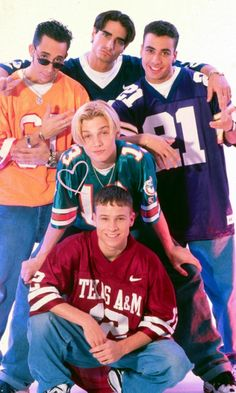 Nick Carter: Backstreet Boys Pose In Sports Jerseys For A Band Snap, 1999