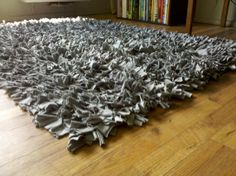 I bought this rug on ETSY for decorating my husband's office. It's made of old gray t-shirts and is fabulous.  It's soft and so far has worn well.  It is definitely a conversation piece.  People always notice and ask about it.  And of course it's made in the USA, is from recycled t-shirts so what's not to love?