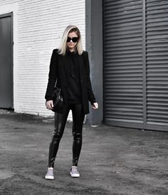 all black: sweatshirt, blazer and fake leather pants.