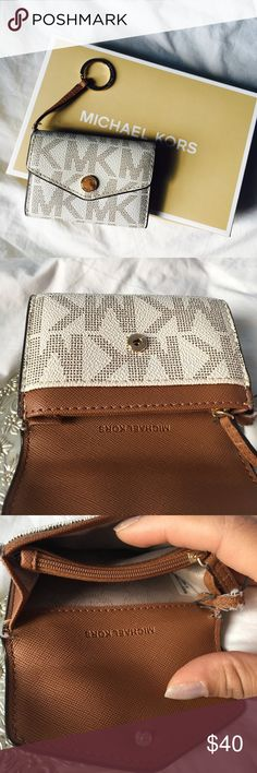Michael Kors Card Holder & Coin Purse ⚜️ Michael Kors Card Holder & Coin Purse. Good condition, the letting strap has some fraying. Inside no stains or holes or scratches. Minor tear at seam as shown. Doesn't come with box. Please specify if you would like the box. Michael Kors Accessories Key & Card Holders
