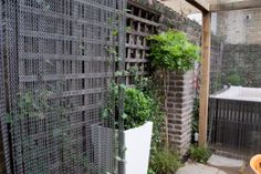 chain curtain and garden planter | by Earth Designs - Garden Design and Build