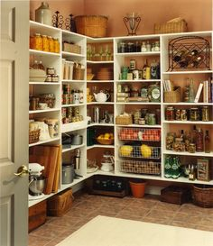 it's too bad my pantry will never look this nice. Organized yes, but home canned/prepared items with room for decorations... no  :(