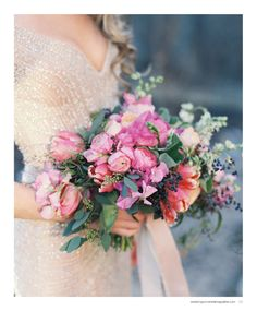 Gorgeous spring bouquet and a sparkly dress. Bouquet by Janie Medley Flora Design, image by Laura Gordon Photography. See more in the Spring 2014 issue of Weddings Unveiled. #wedding  www.weddingsunveiledmagazine.com