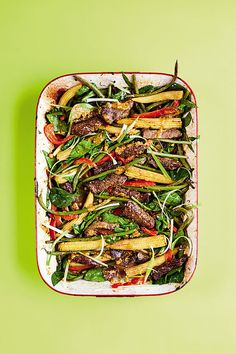 The Quick Roasting Tin chilli peanut beef with red peppers, sweetcorn and spring onions - YOU Magazine Oven Recipes, Rice Recipes, Easy Slimming World Recipes, Roasting Tins, Butter Beans, Chicken Stuffed Peppers, Vegetable Stir Fry, Red Peppers, Beef