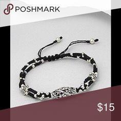Adjustable Black Cotton Bracelet Adjustable Black Cotton Bracelet decorated with silver colored metal beats. Jewelry Bracelets