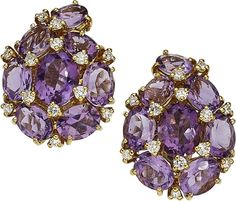 Amethyst, Diamond, Gold Earrings The earrings feature oval-shaped amethyst weighing a total of approximately 17.10 carats, enhanced by full-cut diamonds weighing a total of approximately 0.90 carat, set in 18k gold. Gross weight 21.70 grams. Dimensions: 1-1/8 inches x 13/16 inch