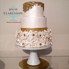 Oh you fancy, huh? Gold and white three tiered cake. Too pretty to eat! But I assure you, you'll want to bite into it because it tastes just as sweet as it looks!