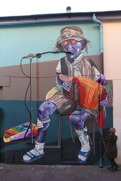 Le musicien joue toujours... / Street art. / Cardiff. / Wales. / Pays de Galles. / By Colab & HB.