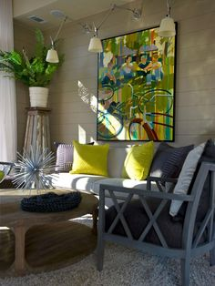 HGTV Green Home 2012:  Living Room design by Linda Woodrum. (*I like the furniture arrangement, lighting and plant stand. But not the actual furnishings).
