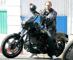 Old ride: Charlie previously has been seen filming while riding a black motorcycle