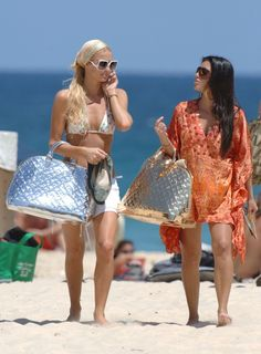 And those contrasting silver and gold shiny bags they carted around everywhere. Sometimes Kim was even allowed to carry the gold one. | A Brief Reminder That Paris Hilton And Kim Kardashian Used To Wear The Same Clothes
