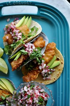 Beer-battered fish tacos are light and crispy and topped with a crunchy radish pico de gallo, avocado slices, and a squeeze of lime. Delicious & dairy free!