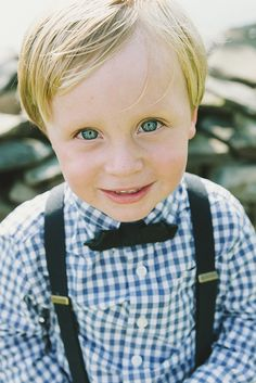 Ring bearer in blue and white checks with suspenders and bow tie. #ringbearer #bowtie #blueeyes #weddingparty http://www.weddingchicks.com/2013/11/04/family-style-wedding/