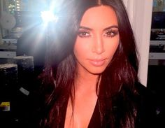 http://www.eonline.com/news/612881/kim-kardashian-bares-cleavage-at-john-legend-s-birthday-party-is-joined-by-kanye-west-robert-de-niro-see-the-photos