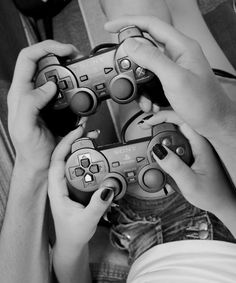 cute picture of boyfriend and girlfriend playing playstation videogames together