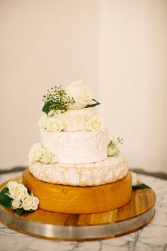 An amazing Cheese Wheel Wedding Cake  Photography: Adrian Tuazon - adriantuazon.com  Read More: http://www.stylemepretty.com/australia-weddings/victoria-au/melbourne/2014/01/30/melbourne-wedding-at-gardens-house-comme/