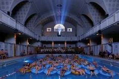 People watch a film at a swimming pool