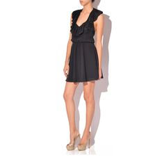 A ruffled neckline enhances the feminine appeal of a back-baring halter dress cut from luminous silk. $129