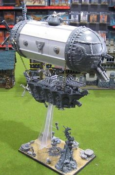 """This is the """"Lead Zeppelin"""" - an rune-imbued steam-powered dirigible for Rich Grabski's Dwarf army. It uses the rules from page 425 of the hardback Warhammer 8th Edition rulebook. Engineered by Rune-Engineer Tokken """"Blacksmith"""" Makaisson, it earned its name from the ridicule Tokken received of """"It'll fly like a lead balloon"""", for attempting to achieve flight in an airship built entirely from that trusty material all Dwarfs love - metal! m/"""