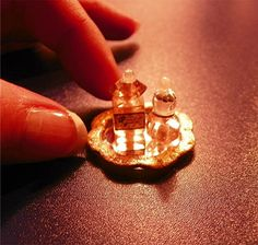 Mini perfume bottles. ~Created by Nina Eary~