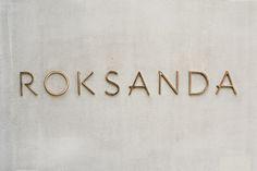 roksanda gold signage on concrete.