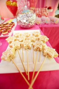 So cute -- friends with little girls, check this out! Fun for a random Saturday dress up even! RICE CRISPIE WANDS at a Princess Fairy Tale Party