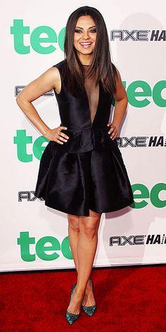 Mila Kunis in a black Dior peplum dress