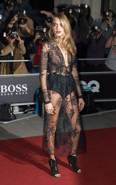 Cara Delevingne at the GQ Men of the Year Awards in London in Burberry Prorsum. See all of the model's best looks.