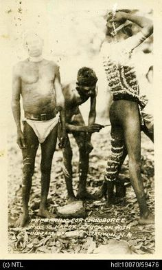 Men preparing for corroboree Date taken:01 January 1930. Collection:Charles Micet Collection. Description:Men preparing for cooroboree, man using Kapok stick to decorate.