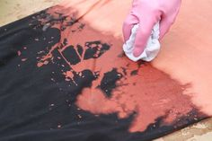 Spruce up an old article of clothing with this cool bleach splattering technique.
