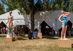 """""""Squawmazon,"""" left, and """"Frieze,"""" right, the works of artist Gary Mitchell stand outside event tents Saturday afternoon, Aug. 13, 2016 during Sculpture in the Park at the Benson Sculpture Garden in Loveland. (Photo by Michael Brian/Loveland Reporter-Herald)"""