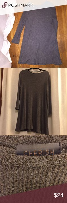 Cherish Grey long sleeve knit dress This is knit long sleeve dress perfect to wear with tights or thigh high socks/boots in the winter. The fit is stretchy with a loose flowy skirt. cherish Dresses Long Sleeve