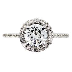 One carat round diamond halo engagement ring: sparkly, glamorous and fit for a princess - pairs well with a snowy Christmas proposal