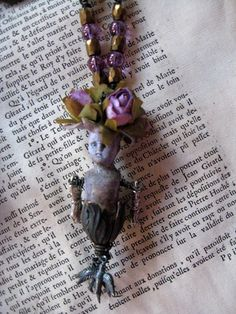A Dream of Orchids frozen charlotte charlie antique doll beaded pendant. $46.00, via Etsy.