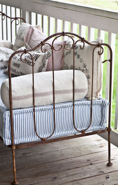 French iron bed (baby crib) converted to a settee for the porch: